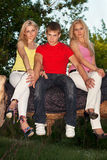 Two attractive blonde and young man Stock Image