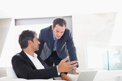 Two attractive business man having a discussion Royalty Free Stock Image