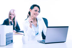 Two attractive business womana working at the office Royalty Free Stock Photography