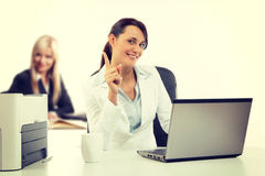 Two attractive business womana working at the office Royalty Free Stock Photos