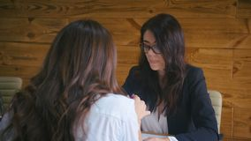 Two attractive business women discussing the new business project in office. Teamwork concept. stock footage