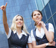 Two attractive business women in formal clothes Stock Photos