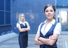 Two attractive business women in formal clothes Stock Images