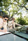 Businessmen meeting around car. Royalty Free Stock Image