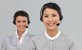 Two attractive businesswomen with headset on Royalty Free Stock Photos