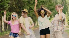 Two attractive couples flirting, dancing together, outdoor party in slow motion. Stock footage stock footage