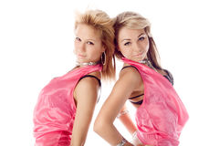 Two attractive dancers in pink costumes Royalty Free Stock Photography