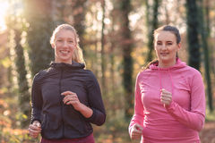 Two attractive fit young ladies out jogging Royalty Free Stock Photos