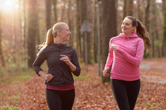 Two attractive fit young ladies out jogging Royalty Free Stock Photo