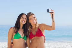Two attractive friends taking pictures Royalty Free Stock Photos