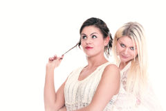 Two attractive girl friends - blond and brunette smiling Stock Photography