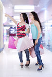 Two attractive girl in shopping center Royalty Free Stock Photography