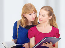 Two attractive girlfriends, college students. With books stock images