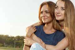 Two attractive girlfriends in the park Royalty Free Stock Photos