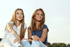 Two attractive girlfriends in the park Royalty Free Stock Images