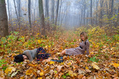 Two attractive girls. In the autumn forest Stock Photography