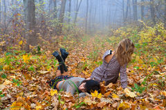 Two attractive girls. In the autumn forest Stock Image