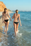 Two attractive girls in bikini at the sea Royalty Free Stock Image
