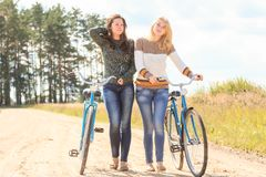Two attractive girls during cycling Royalty Free Stock Photography