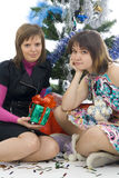 The two attractive girls with gifts. Isolated on a white background Stock Photo