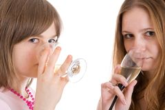 Two attractive girls with glasses of wine isolated Stock Photos