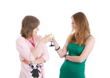 Two attractive girls with glasses of wine isolated. On a white background Royalty Free Stock Photos