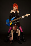 Two attractive girls with guitar Stock Photo