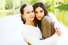 Two attractive girls in the park. Two attractive girls  in the park in sunny summer morning Stock Photos
