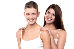 Two attractive girls posing in sleeveless spaghetti Stock Images