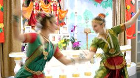 Two attractive girls. In a sari dance a national dance stock footage