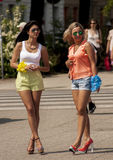 Two attractive girls on the street. SZCZECIN, POLAND - MAY 29, 2014: Many pretty girls you may see in Poland Stock Photo