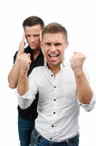 Two attractive guys swear. White background. Royalty Free Stock Photography