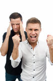 Two attractive guys swear. White background. Stock Photos
