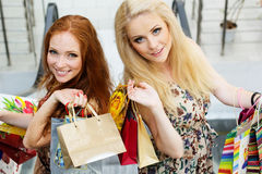 Two attractive happy girls out shopping Royalty Free Stock Photography