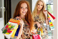 Two attractive happy girls out shopping Stock Photo