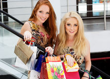 Two attractive happy girls out shopping Stock Images