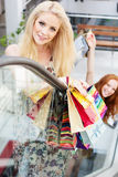 Two attractive happy girls out shopping Stock Photography