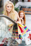Two attractive happy girls out shopping Royalty Free Stock Photos