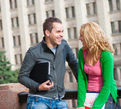 Two attractive happy students Royalty Free Stock Photo