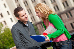 Two attractive happy students. Talking at campus Royalty Free Stock Images
