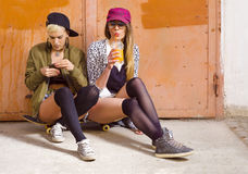 Two attractive hipster girls hanging out Stock Photo