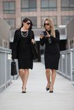Two attractive hispanic businesswomen outdoor Stock Photography