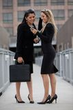 Two attractive hispanic businesswomen outdoor Stock Image