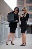 Two attractive hispanic businesswomen outdoor Stock Image
