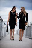 Two attractive hispanic businesswomen walking Royalty Free Stock Photos
