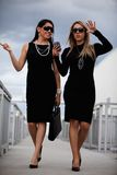 Two attractive hispanic businesswomen walking Royalty Free Stock Images