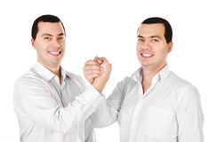 Two attractive positive smile young men twins isolated Royalty Free Stock Image