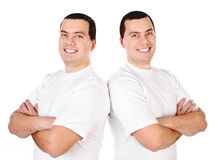 Two attractive positive smiling young men twins Royalty Free Stock Image
