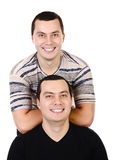 Two attractive positive smiling young men twins isolated Stock Photos