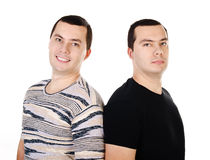 Two attractive positive smiling young men twins isolated Royalty Free Stock Image